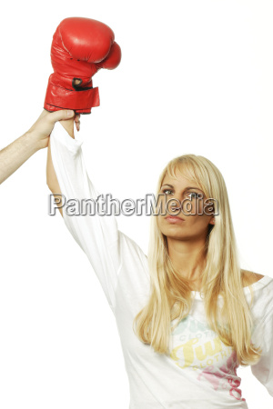 woman with red boxing glove winning