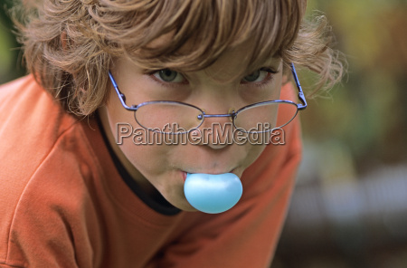 boy chewing bubble gum