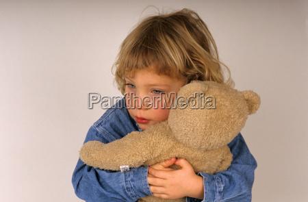 girl 2 3 hugging teddy bear