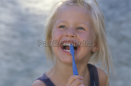 girl 2 3 with toothbrush