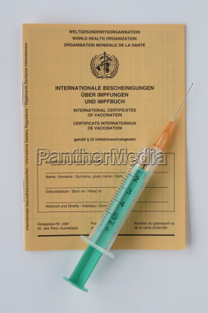 syringe on vaccination card close up