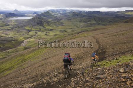 iceland men mountain biking in hilly