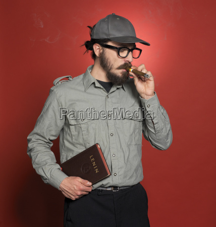 mature man standing with book smoking