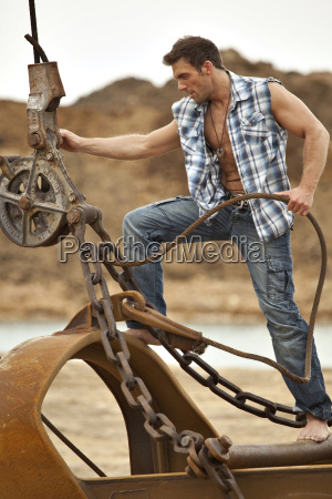 germany bavaria man pulling chain with