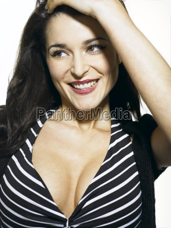 young woman wearing striped dress smiling