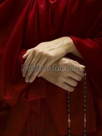 hindu with rosary praying