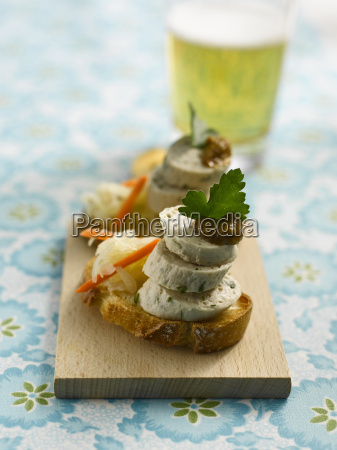 fingerfood with slices of baguette and