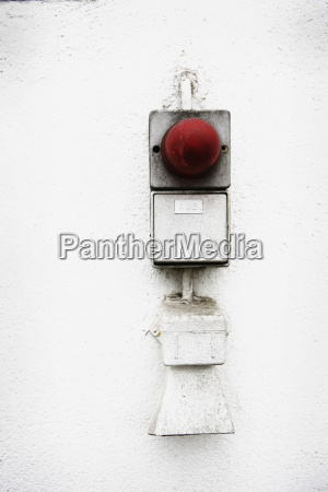 germany alert button on housewall close