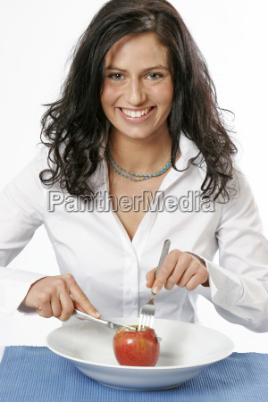 young woman with apple in plate