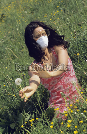woman wearing a mask and protective