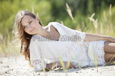 germany bavaria young woman lying on