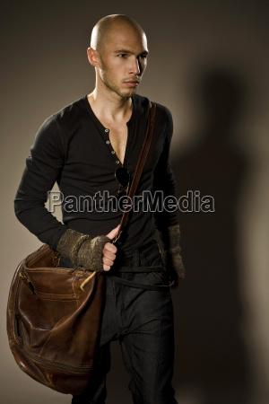 young man with shoulder bag portrait