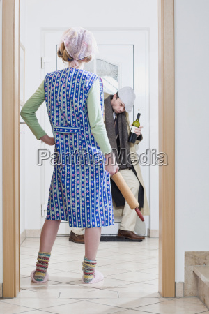 man coming home woman waiting with