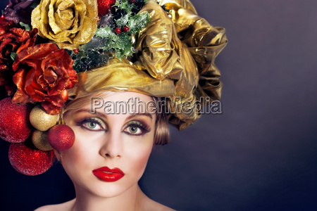 young woman wearing christmas decoration hat