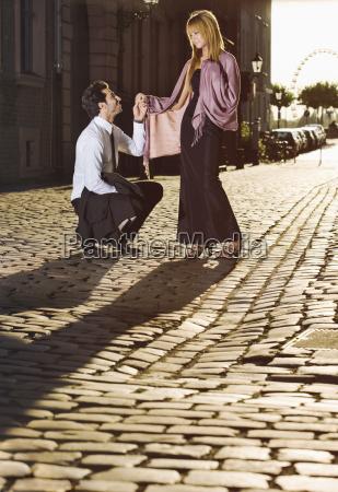 germany duesseldorf young couple man kneeling