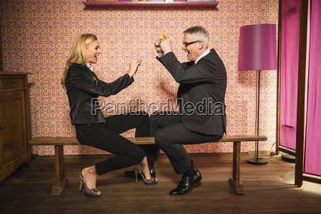 germany stuttgart businessman and woman playing
