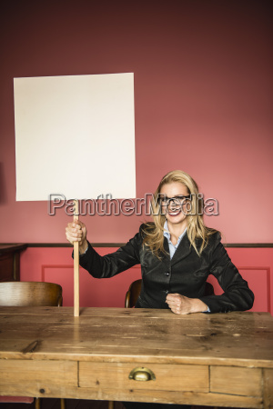 germany stuttgart businesswoman holding blank sign