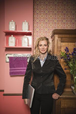 germany stuttgart businesswoman standing with laptop