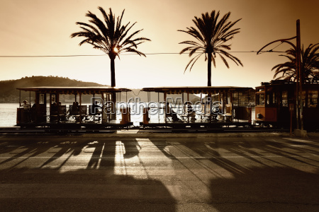 spain mallorca people in electric tramway