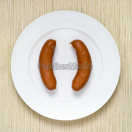 sausage on plate elevated view