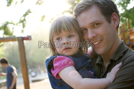 father holding daughter 3 4 portrait