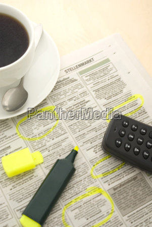 cup of coffee newspaper and marker