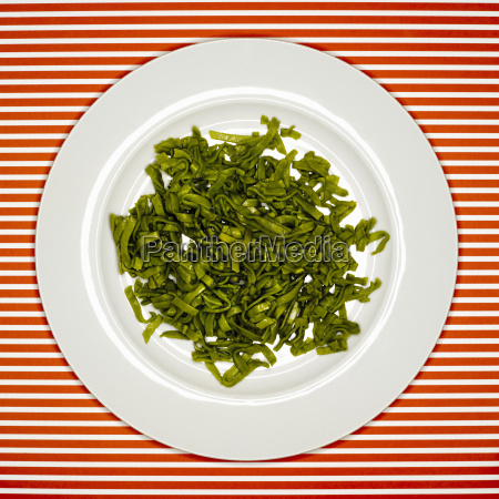 uncooked fettuccine on plate elevated view