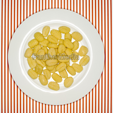 uncooked, , gnocchi, on, plate, , elevated - 21179931