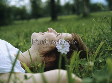 woman laying in meadow
