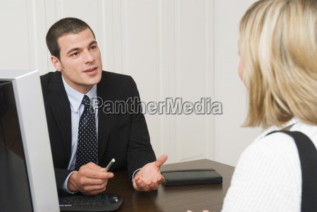 bank representative talking with client