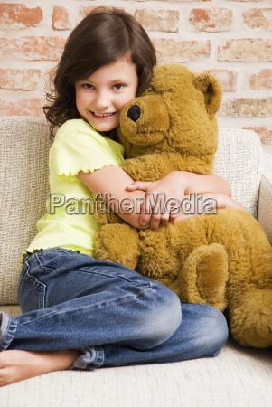 girl 8 9 hugging teddy bear