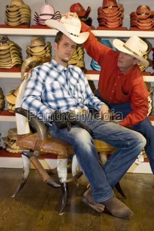 usa texas dallas man buying cowboy
