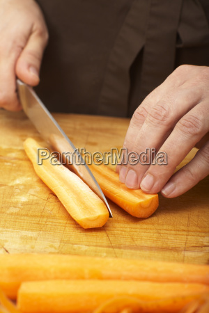 cutting carrot in half crosswise close