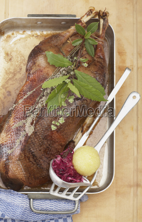 roasted goose in roasting tray with
