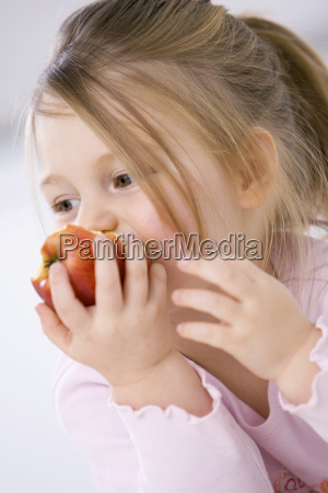 little girl 3 4 eating an