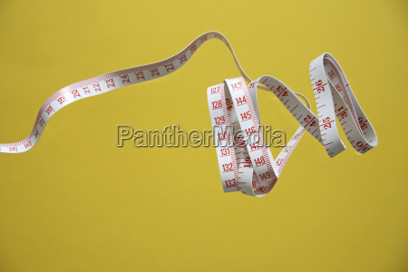 coiled measuring tape close up