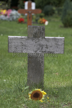 wooden cross on grave yard