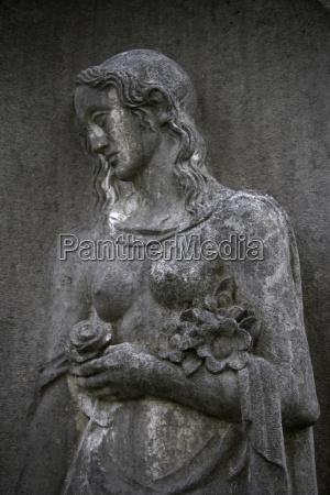 germany hamburg graveyard statue close up
