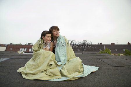 young couple wrapped in blanket