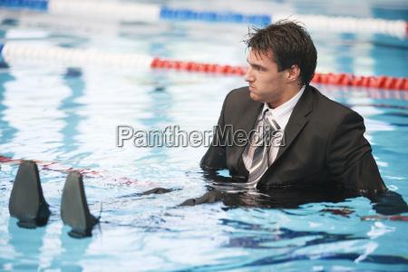 businessman sitting in pool