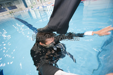 businessman getting drowned