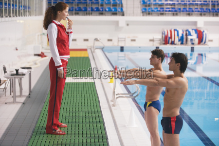 young woman training two athletes