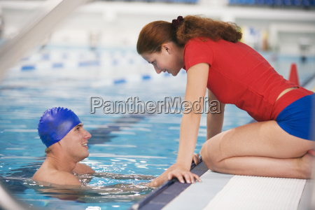 young woman talking to swimmer