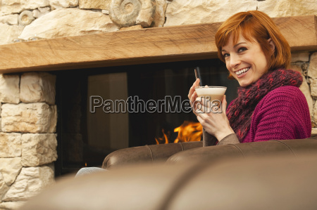 woman in living room holding glass