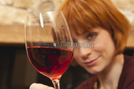 woman holding a glass of red