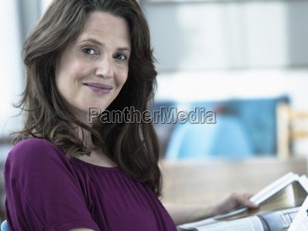 germany hamburg woman holding magazine portrait