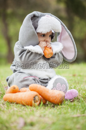 little baby girl wearing a rabbit