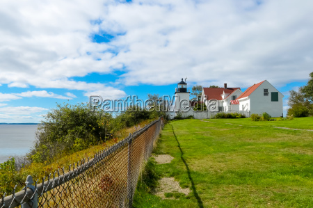 lighthouse by the fence