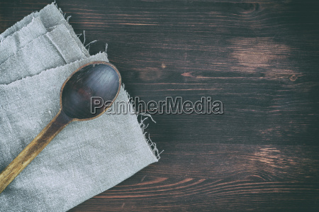 old wooden spoon on a gray