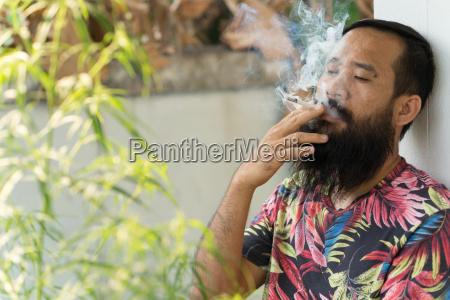 adult man smoking cigarette